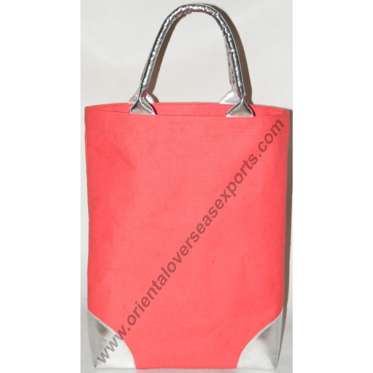Jute Cotton Bag With Silver Leather Look Handles and bottom patches.