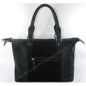 Leather handbag with Zip-top closure, multiple pockets and luxury lining inside
